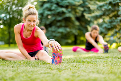 Blond woman streching before jogging